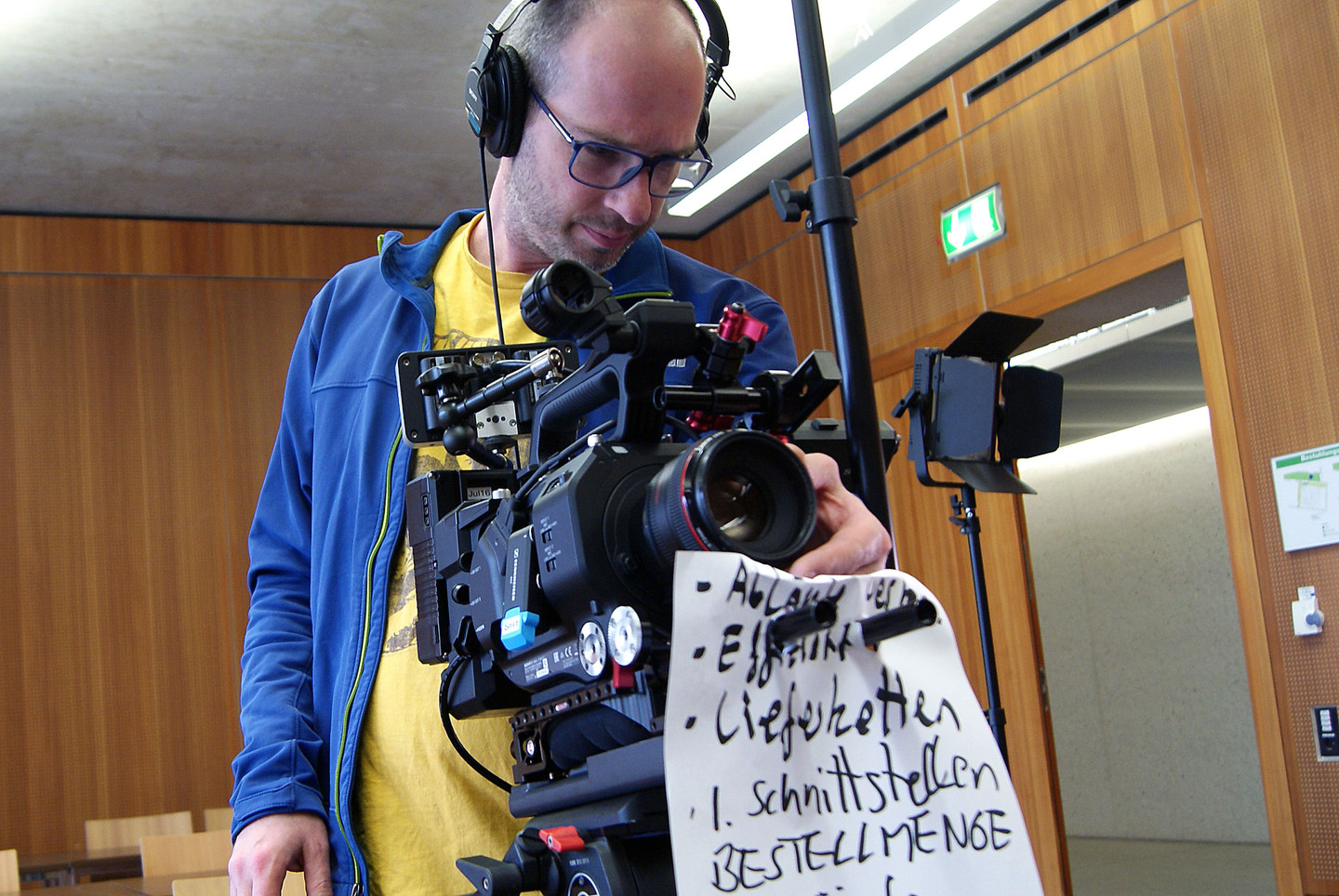 A cameraman in action: filming an online lecture